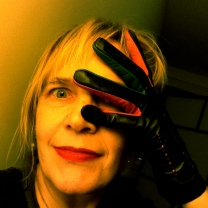 Selfie with spiffy new glove(s) - black leather, with pink, green and orange insets.