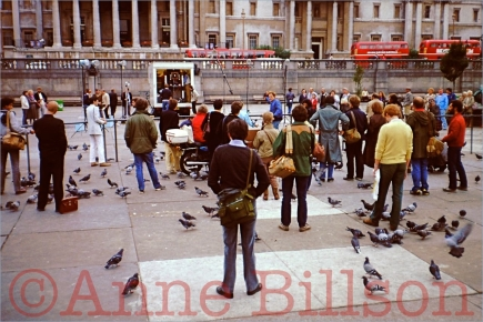 Photographers taking part in the One Day in the Life of London project assemble in Trafalgar Square.