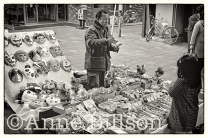Man selling masks and toys.