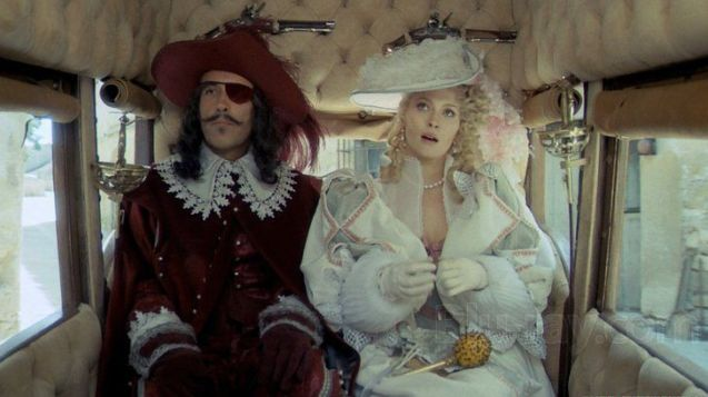 Christopher Lee as Rochefort and Fay Dunaway as Milady in The Three Musketeers (1973).