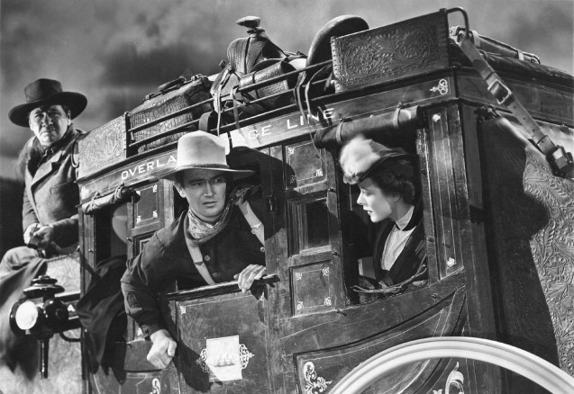 George Bancroft, John Wayne and Louise Platt in Stagecoach (1939)
