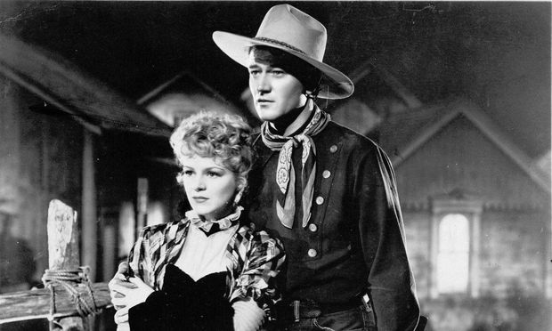 Claire Trevor and John Wayne in Stagecoach (1939)