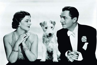 Asta the dog with Myrna Loy and William Powell in a publicity shot for The Thin Man.