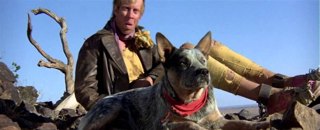 Mad Max's dog guarding the Gyro Captain (Bruce Spence) in Mad Max 2.